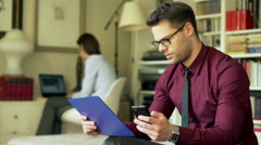 Businesscouple working at home and man reading graphs Stock Footage