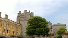 Panoramic view of upper parts of walls, buildings, towers near gate to Windsor Stock Footage