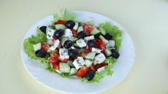 Fresh salad with olive oil - stock footage