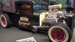 4k Moon Ford Pickup and Ford Coupé Hot Rods at motorshow - stock footage