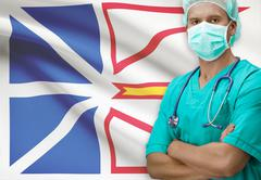 Surgeon with Canadian province flag on background - Newfoundland and Labrador Stock Photos