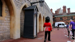 Windsor Castle. British Guards in red uniforms are most famous in the world Stock Footage