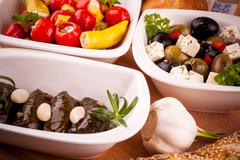 Stock Photo of Mediterranean antipasto, vine leaves stuffed with peppers