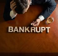 Word Bankrupt and devastated man composition Stock Photos