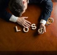 Word Loss and devastated man composition - stock photo