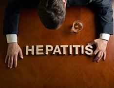 Word Hepatitis and devastated man composition - stock photo