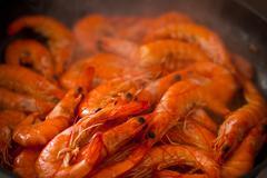 Spanish fried chilli garlic shrimp tapas in pan Stock Photos