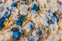 Backgrounds, abstraction. sand, strewn with snow. Stock Photos