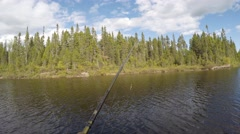 Casting a fishing rod 4k pov Stock Footage