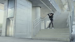 Sexy, black haired girl dancing in abandoned concrete place Stock Footage