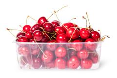 Red juicy sweet cherries in a plastic tray Stock Photos