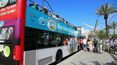 Sightseeing bus and tourists in Sea Port of Barcelona, Spain Stock Footage