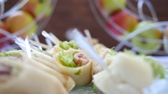 Catering laying out of food on a buffet table - empanadas Stock Footage