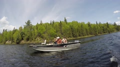 4k boat pulls away from boat Stock Footage
