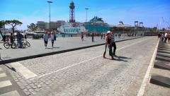 Tourists walk at the Sea Port in Barcelona, Spain Stock Footage
