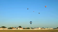 Hot Air Balloons drift upper right. Rio Claro, Sao Paulo, Brazil Stock Footage