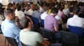 Audience listening to coach speaker at educational business meeting conference Footage
