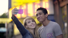 Cute Couple On A Date Pose For Selfies Outside A Movie Theater, Then Go Inside Stock Footage