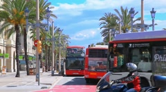 Sightseeing bus and tourists on the street in Barcelona, Spain Stock Footage