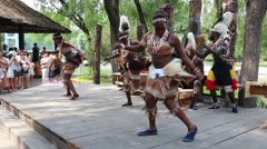 Africans perform dance in front of park visitors, Beijing World Park, Ch Stock Footage