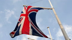 British flag waving in wind in UK, United Kingdom, national symbol Stock Footage