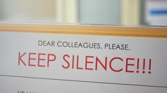 Keep silence sign reminder at conference - stock footage