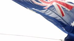 Australian flag waving against blue sky Stock Footage