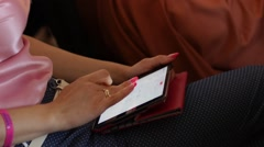 Woman with her tablet computer at business meeting conference Stock Footage