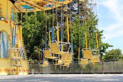 Carousel swing at the fair - stock photo