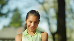 Young girl on a see-saw in a park Stock Footage