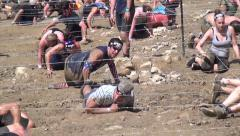 Obstacle and Adventure Race, under barbed wire in mud Stock Footage