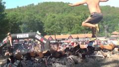 Obstacle and Adventure Race Jumping over Firepit Stock Footage