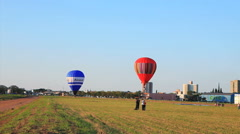 Hot Air Balloons Against A Brights Blue Sky. Stock Footage