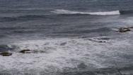 Stock Video Footage of ROUGH SEAS hit rocky shoreline