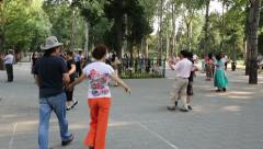 Vacationers people are dancing in a city park for fun, Beijing Stock Footage