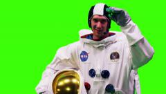NASA astronaut giving a salute on a chroma key green screen Stock Footage
