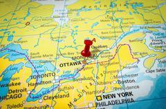 Red thumbtack in a map, pushpin pointing at Ottawa city Stock Photos