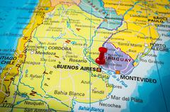 Red thumbtack in a map, pushpin pointing at Buenos Aires city - stock photo