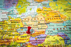 Red thumbtack in a map, pushpin pointing at Vienna city - stock photo