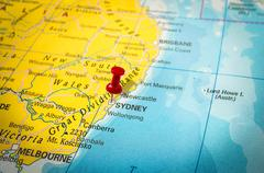 Red thumbtack in a map, pushpin pointing at Sydney city, Australia - stock photo