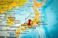 Red thumbtack in a map, pushpin pointing at Osaka city Stock Photos