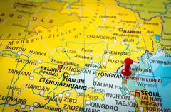 Red thumbtack in a map, pushpin pointing at Pyongyang city Stock Photos