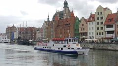 Gdansk, Poland. Ferry on the river. Old town in the background Stock Footage