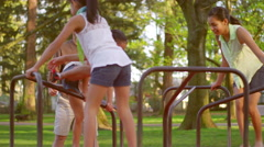 Father pushing his daughters on a merry-go-round - stock footage