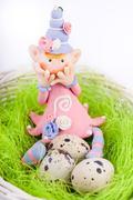 Ashamed fairy on the nest with quail eggs - stock photo