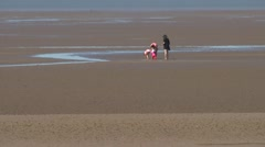 Family in l/s on sand Stock Footage