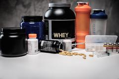 Bodybuilding nutrition supplements and chemistry Stock Photos
