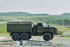 Army truck URAL-4320 jumps through obstacle Stock Photos