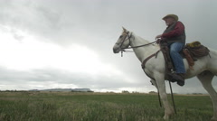 Senior cowboy on Horse - Low angle Dolly Right  Medium Stock Footage
