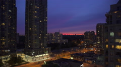Establishing shot of buildings and beautiful and colorful evening sky. 4K UHD Stock Footage